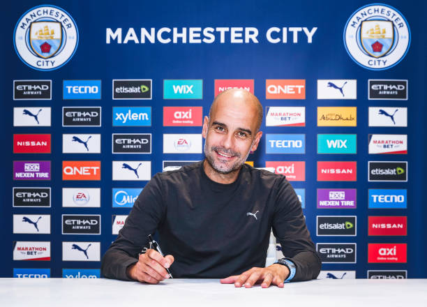 Pep Guardiola signs contract extension at City