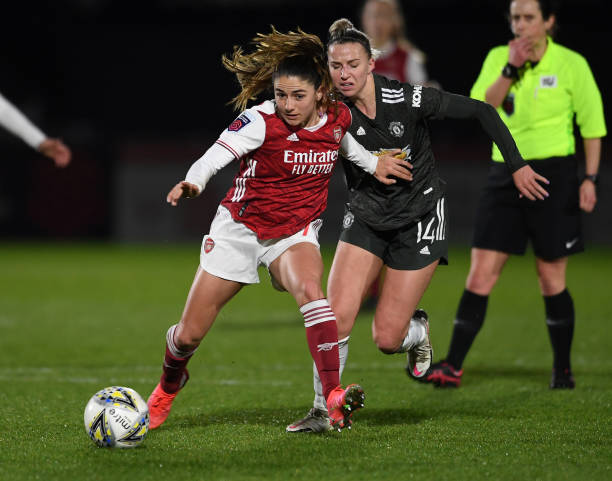 Arsenal's Danielle van de Donk and Manchester United's Jackie Groenen in action in the WSL