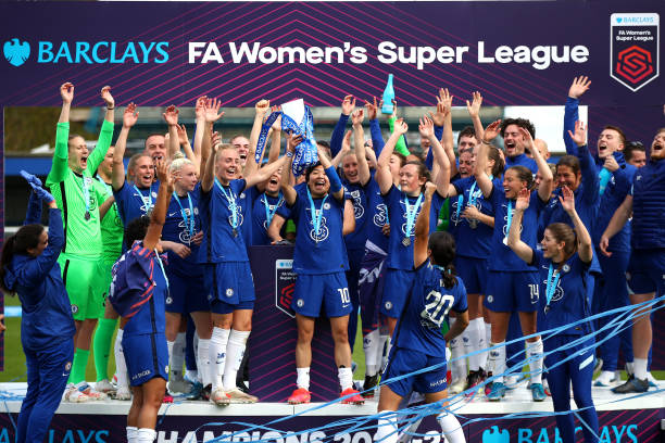 Chelsea celebrate retaining the WSL title after beating Reading on the final day