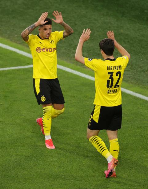 Jadon Sancho and Gio Reyna celebrate a Borussia Dortmund goal versus Holstein Kiel in their DFB Pokal success